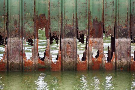Old rotting metal on a falling apart river dock Reklamní fotografie
