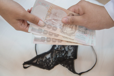 Man paying prostitute for sex - prostitution and escort concept Stock Photo