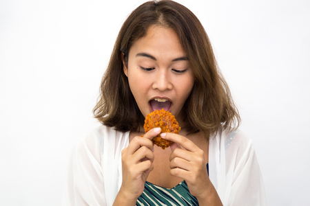 Happy young asian woman with fried chicken, she holding fried chicken in her hand, isolated white background Stock Photo