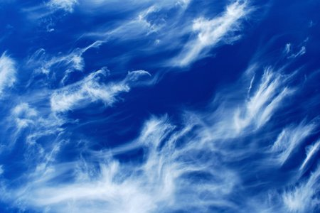 Cirrus clouds in the blue sky photo