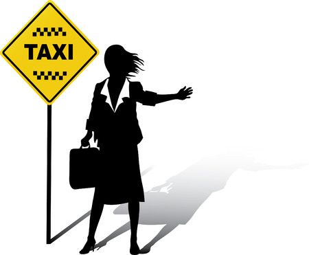 Business woman catches a Taxi in the street