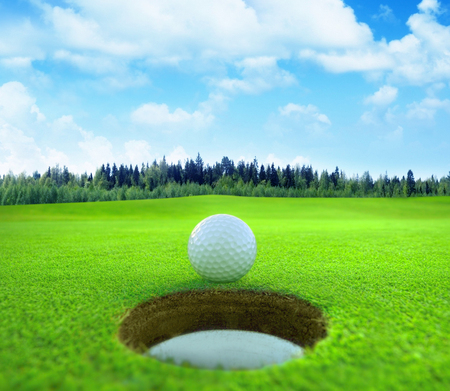 Golf ball on natural landscape. Stock Photo