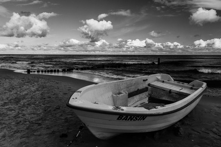 eos: boat on the beach at the Iceland of Usedum. Stock Photo