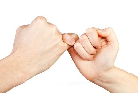 Man and woman making a pinky promise Hands isolated on white background