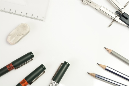 drawing compass: Background made of ruler, drawing compass, technical pens, pencils, rubber gum isolated on white background