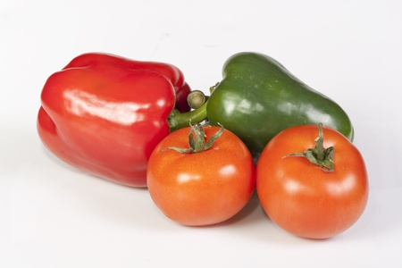 Two peppers and tomatos isolated on white background. Stock Photo