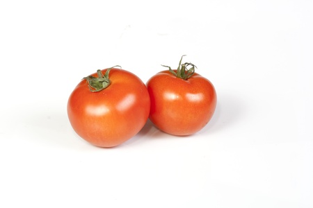 Two tomatos isolated on white background.