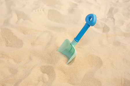 Shovel toy on sand,beach summer and vacation concepts with kid