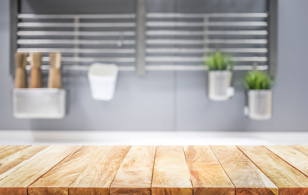Wood table top on blur kitchen room background .For montage product display or design key visual layout. Stockfoto