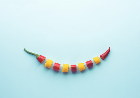 Two color of chilli slice with copy space on pastel background.flat lay design idea 版權商用圖片