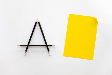 Creativity and inspiration ideas with pencil and paper on white background.Top view worktable.