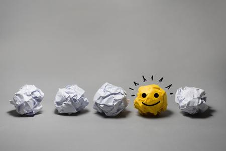 Yellow crumpled paper ball.Business creativity,leadership concept ideas 版權商用圖片