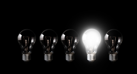 Light bulbs with glowing one outstanding dark background.Business and motivation concept ideas.