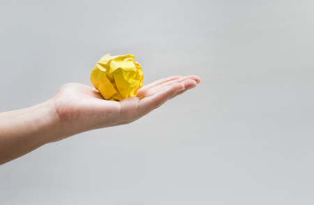 Paper crumpled ball on human hand.Idea concepts Imagens - 119293049