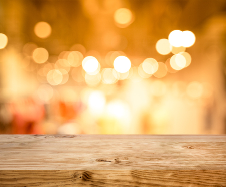Wood texture table top (counter bar) with blur light gold bokeh in cafe,restaurant background.For montage product display or design key visual layou Reklamní fotografie
