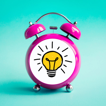 Inspiration ideas concepts with light bulb icon icon in alarm clock.Time and dateline.performance of human