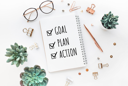 Goal,plan,action text on notepad with office accessories.Business motivation,inspiration,professional performance concepts