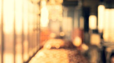 Blurred abstract light gold glass wall from building room background.