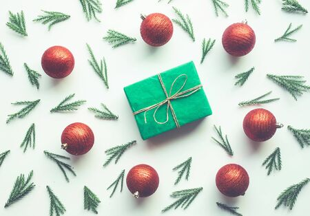 Christmas celebration concepts with pine branch and gift box and red ball ornament decoration on white background.winter season idea design