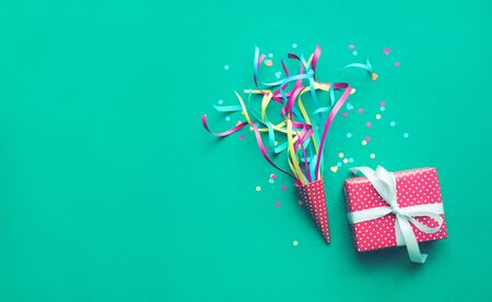 Celebration,party backgrounds concepts ideas with colorful confetti,streamers and gift box.Flat lay design Stock Photo