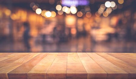 Wood texture table top (counter bar) with blur light gold bokeh in cafe,restaurant background.For montage product display or design key visual layou Stock fotó