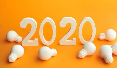 2020 creativity inspiration concepts with text nuber and lightbulb on color background.Business resolution,action plan ideas.glowing contents Stockfoto