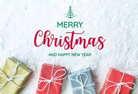 Merry christmas and happy new year text with gift box,present on snow background.For festival and celebration concepts ideas.Top view