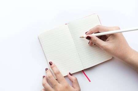 Female hand writing on notepad.idea and inspiration concepts ideas