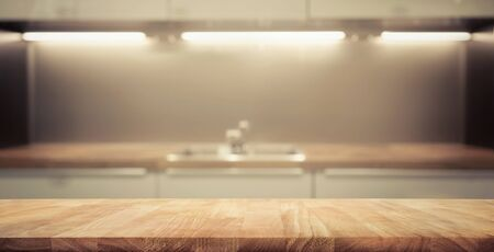 Wood table top on blur kitchen room background .For montage product display or design key visual layout. 版權商用圖片