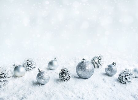 Christmas ball (ornament) on snow background.For christmas concepts or new year,celebration ideas.copy space