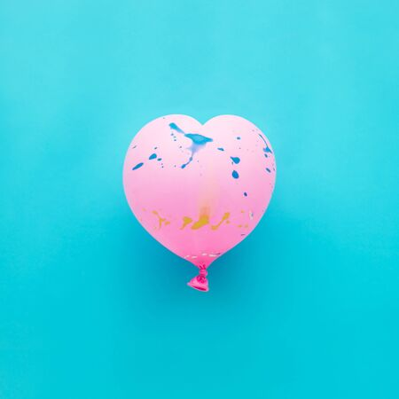 Pink balloon heart  shape on blue background party celebration concept ideas