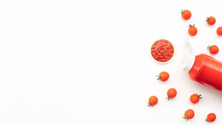 Fresh tomato with tomato bottle sauce (ketchup)on white background.Organic food ingredient and healthy eating concepts ideas.top view