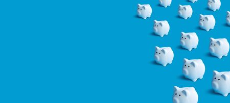 Piggy bank group pastel color background.money and financial concepts ideas