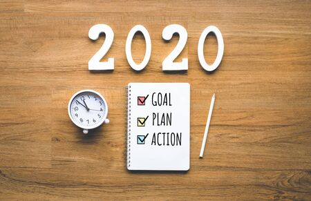 2020 new year goal,plan,action text on notepad on wood background.Business challenge.Inspiration ideas.Human performance 스톡 콘텐츠