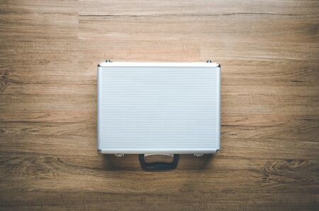 Above of metal briefcase(Box)on wooden floor background.Tool and security concepts ideas 写真素材