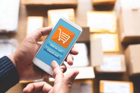 Online shopping concepts with youngman using smartphone for payment his order on a lot of product packag box.Ecommerce market.Business retail.modern life. Stock fotó