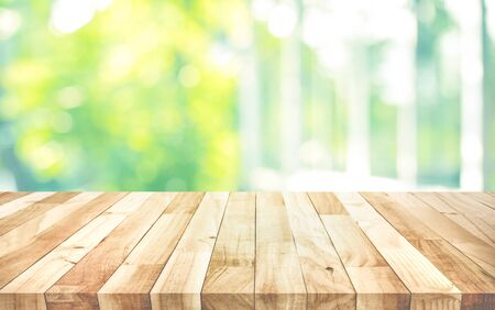 Empty wood table top on blur abstract green garden from window view background.For montage product display or design key visual layout Stock Photo