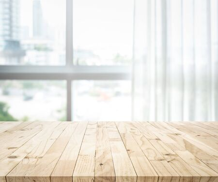Empty of wood table top on blur of white curtain with window view background.For montage product display or design key visual layout