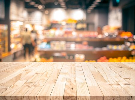 Wood texture table top (counter bar) with blur grocery,market store background.For montage product display or design key visual layout
