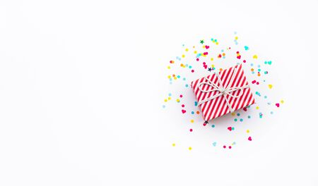 Celebration anniversary and party concepts ideas with colorful gift box present and confetti element on white color background.Top view design template and copy space