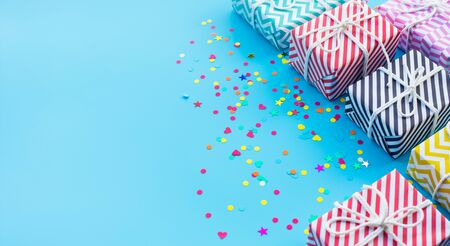 Celebration anniversary and party concepts ideas with colorful gift box present and confetti element on blue color background.Top view design template and copy space Stock fotó