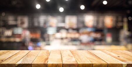 Wood texture table top (counter bar) with blur cafe,restaurant background.For montage product display or design key visual layout Reklamní fotografie