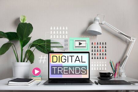 Digital trends with modern graphic and text on laptop on desk table.business online.Social communication.no people