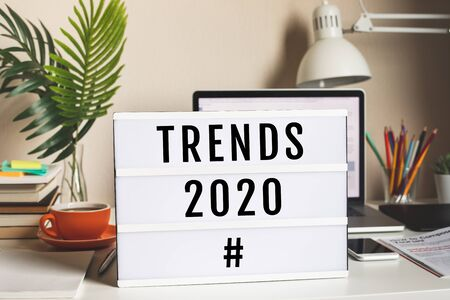Trends 2020 concepts with text on cinema light box on worktable.business vision,research analysis