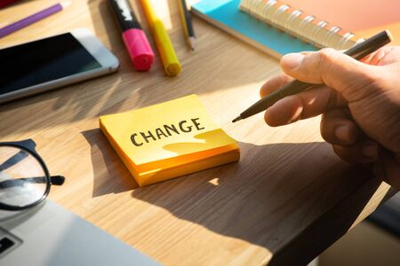 Change concepts with person writing text on notepaper.business motivation Archivio Fotografico