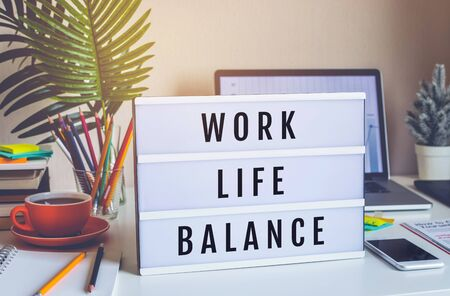 Work Life Balance concepts with text on light box on desk table in home office.positive emotion to success.body healthy