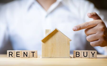 Property real estate concepts.rent or buy house.investment planning.banking and interest rate.investor thinking analysis
