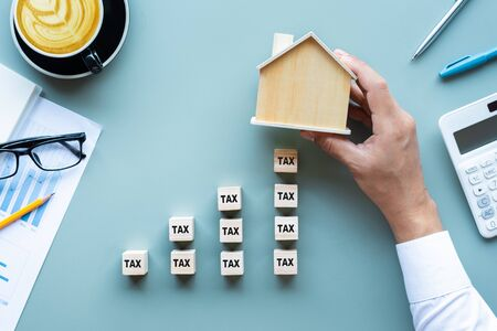 Property tax.investment planning.business real estate.economy crisis.expenses of worker.rent or buy house.top view Stock Photo
