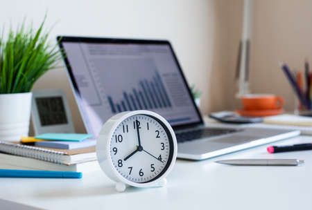Business concepts with clock on desk.For investment analysis,waiting to sucess ideas.time and working day