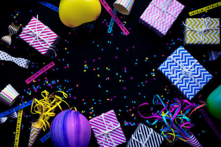 Let's celebrate party concepts with colorful anniversary prop on dark with copy space background.funny and festival activity ideas